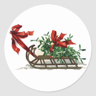 Sled with Bunch of Mistletoe Tied in Red Ribbon Classic Round Sticker
