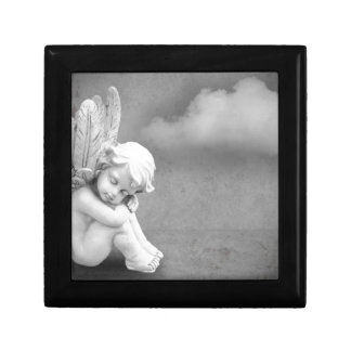 Sleeping angel on grey background, angelic art jewelry box