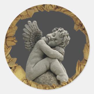Sleeping Cherub Angel Sculpture Round Sticker. Classic Round Sticker
