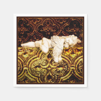 Sleeping cherub on golden glass paper napkin