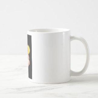 Sleeping newborn duckling in human hands coffee mug