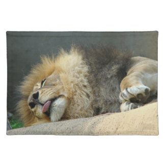 Sleepy lion sticking out the tongue Placemat