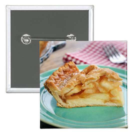 Slice of fresh baked apple pie on plate button