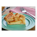 Slice of fresh baked apple pie on plate greeting card