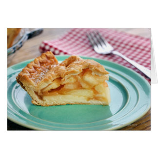 Slice of fresh baked apple pie on plate card