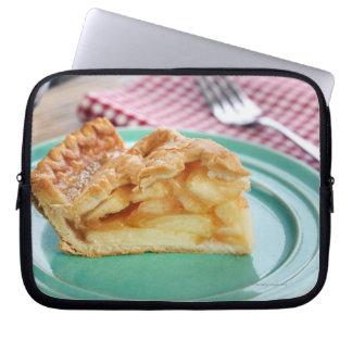 Slice of fresh baked apple pie on plate laptop sleeve