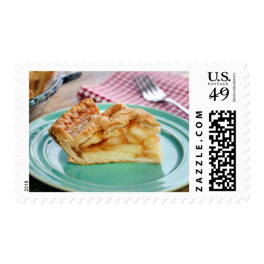 Slice of fresh baked apple pie on plate postage