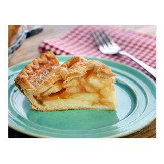 Slice of fresh baked apple pie on plate postcard