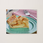 Slice of fresh baked apple pie on plate puzzles