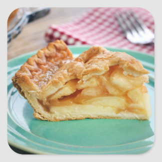 Slice of fresh baked apple pie on plate square sticker