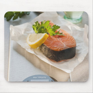 Slice of salmon on weight scale mouse pad