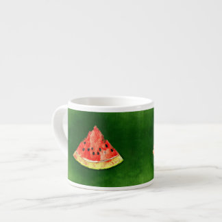 Slice of watermelon on green background espresso cup