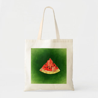 Slice of watermelon on green background tote bag