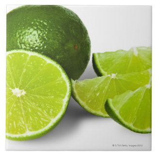 Sliced lime wedge, on white background, cut out ceramic tile