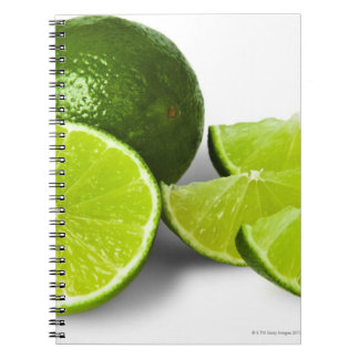Sliced lime wedge, on white background, cut out spiral notebook