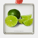 Sliced lime wedge, on white background, cut out square metal christmas ornament
