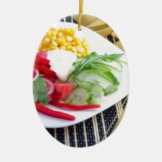 Slices of fresh raw vegetables ceramic ornament