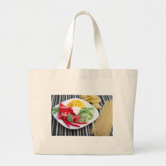 Slices of fresh raw vegetables large tote bag