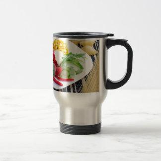 Slices of fresh raw vegetables travel mug