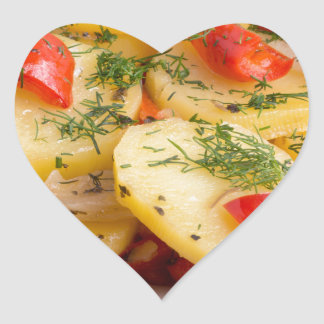 Slices of stewed potatoes and peppers on sackcloth heart sticker