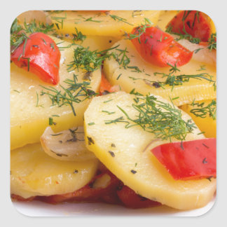 Slices of stewed potatoes and peppers on sackcloth square sticker