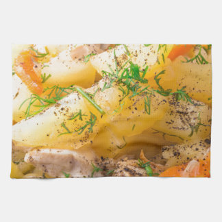 Slices of stewed potatoes, chicken, carrot hand towel