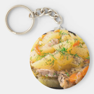 Slices of stewed potatoes, chicken, carrot keychain