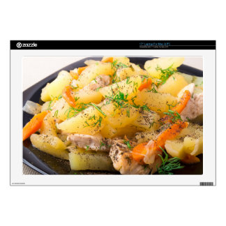 Slices of stewed potatoes, chicken, carrot laptop decal