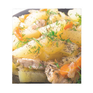 Slices of stewed potatoes, chicken, carrot notepad