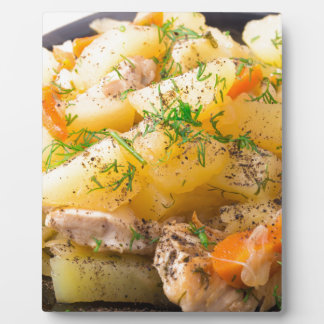 Slices of stewed potatoes, chicken, carrot plaque