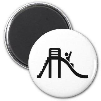Slide playground magnet