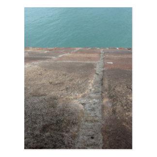 Sliding into the blue sea postcard