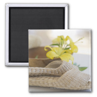 Slippers beside a wooden bowl with yellow lilies 2 inch square magnet