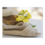 Slippers beside a wooden bowl with yellow lilies postcard