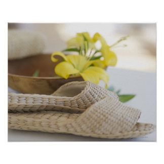 Slippers beside a wooden bowl with yellow lilies poster