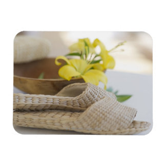 Slippers beside a wooden bowl with yellow lilies rectangular photo magnet