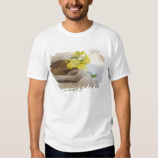 Slippers beside a wooden bowl with yellow lilies shirt