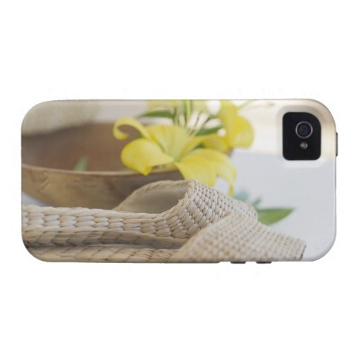 Slippers beside a wooden bowl with yellow lilies vibe iPhone 4 cases
