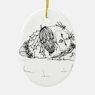 Slipping owl ceramic ornament