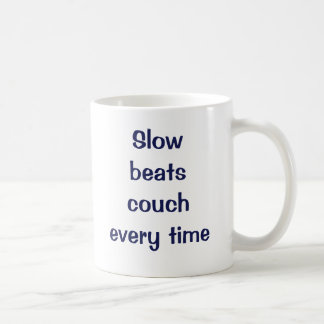 Slow beats couch every time coffee mug