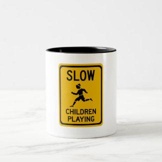 Slow - Children Playing, Traffic Warning Sign, USA Two-Tone Coffee Mug