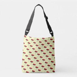Small allover red blue poppy print on cream crossbody bag
