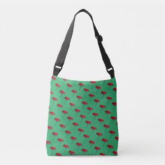Small allover red blue poppy print on green crossbody bag
