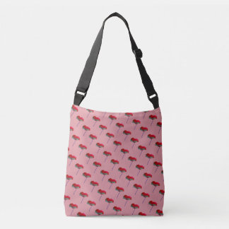 Small allover red blue poppy print on pink crossbody bag