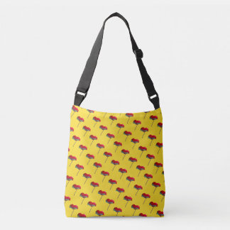 Small allover red blue poppy print on yellow crossbody bag