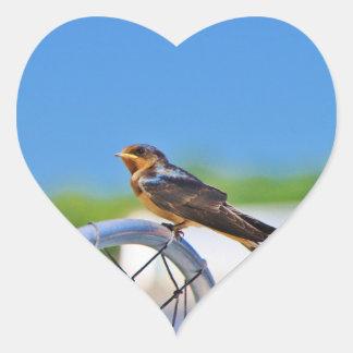 Small bird on a net heart sticker