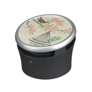 Small Birds Perched on a Branch and on a Birdcage Bluetooth Speaker