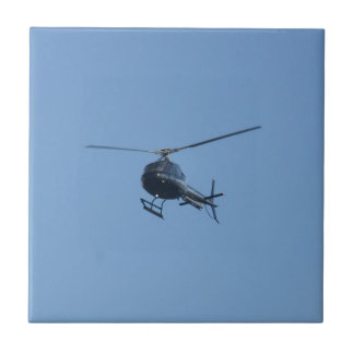Small black helicopter. small square tile