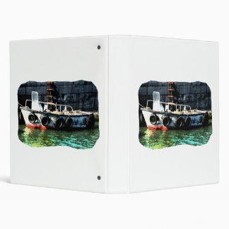 Small boat ladder tires in ocean by tug binder