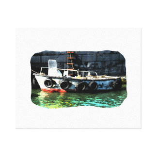 Small boat ladder tires in ocean by tug canvas print